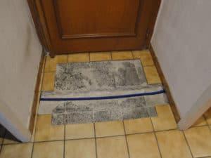 Travaux pour créer un tapis d'entrée encastré